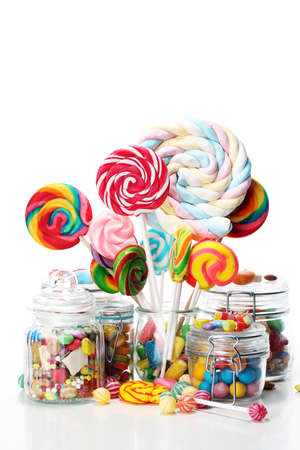 candies with jelly and sugar. colorful array of different childs sweets and treats in glass jar
