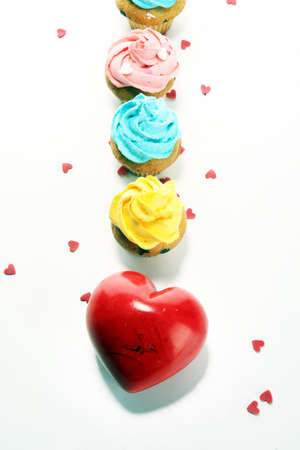 Delicious cupcake for Valentine Day with hearts. Traditional homemade with red roses Stock Photo