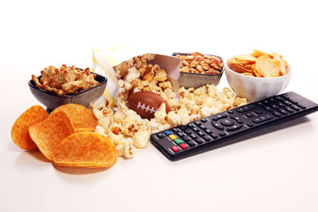 Chips, salty snacks, football on a table. Great for Bowl Game. Archivio Fotografico