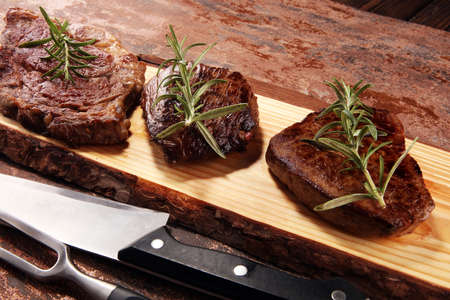 Barbecue Rib Eye Steak. Black Angus Prime meat steaks Machete, Striploin, Rib eye, Tenderloin fillet mignon