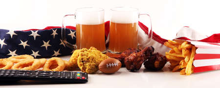 Chips, salty snacks, football and Beer on a table. Great for Bowl Game projects. Фото со стока