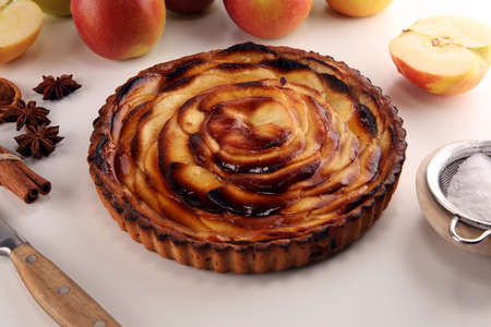 Apple tart. Gourmet traditional holiday apple pie sweet baked dessert food with cinnamon and apples on table for dessert Stock Photo