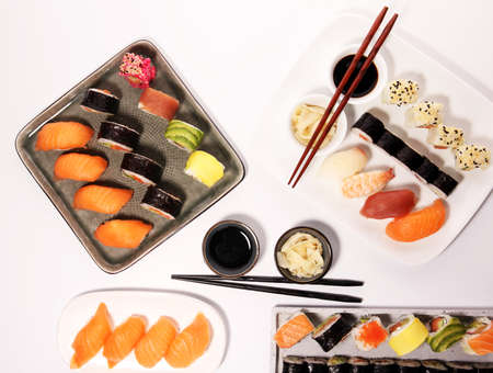 close up of sashimi sushi set with chopsticks and soy - sushi roll with salmon and sushi roll with smoked eel, selective focus. Reklamní fotografie - 117359162