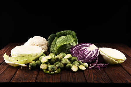organic cabbage heads. Antioxidant balanced diet eating with red cabbage, white cabbage and savoy. cauliflower and Brussels sprouts Archivio Fotografico