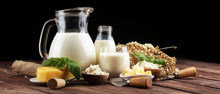 milk products. tasty healthy dairy products on a table and milk jar, glass bottle and cheese Imagens
