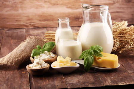 milk products. tasty healthy dairy products on a table and milk jar, glass bottle and cheese Фото со стока