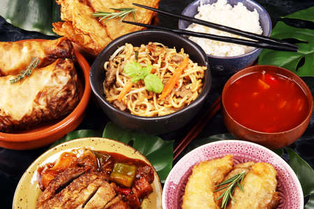 Assorted Chinese food set. Chinese noodles, fried rice, peking duck, dim sum, spring rolls. Famous Chinese cuisine dishes on table. Chinese restaurant concept. Asian style banquet Stock fotó