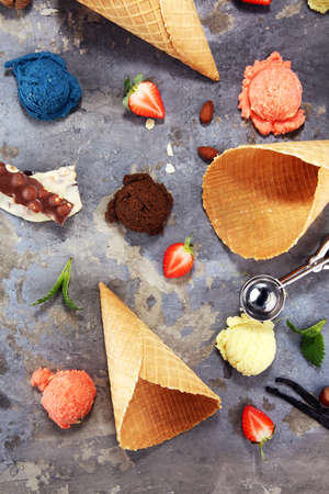 Set of ice cream scoops of different colors and flavours with berries and fruits decoration. icecream variation