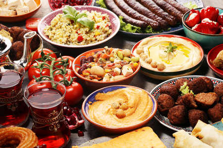 Middle eastern or arabic dishes and assorted meze, concrete rustic background. Falafel. Turkish Dessert Baklava with pistachio. Stock fotó