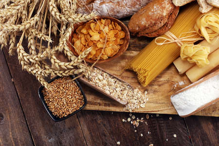 whole grain products with complex carbohydrates on rustic table