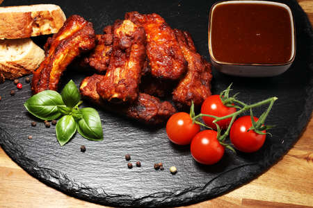 Spicy hot grilled spare ribs from a summer BBQ Stock Photo