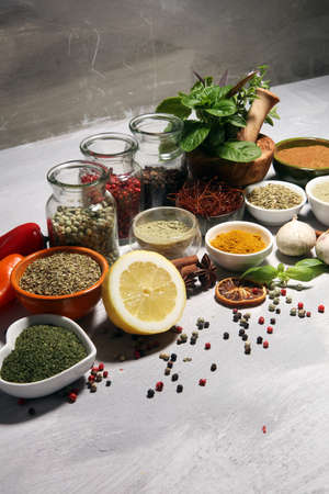 Spices and herbs on table. Food and cuisine ingredients on white table