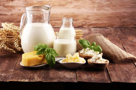 milk products. tasty healthy dairy products on a table and milk jar, glass bottle and cheese Zdjęcie Seryjne