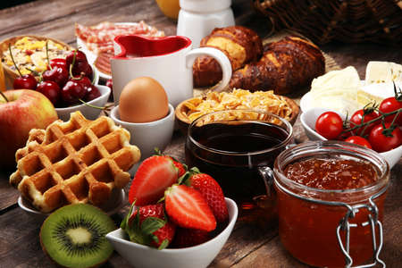 Breakfast served with coffee, orange juice, croissants and strawberry, jam and tea. Stock Photo