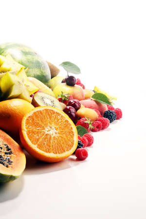 Fresh summer fruits with apple, peach, berries, pear and apricot on white