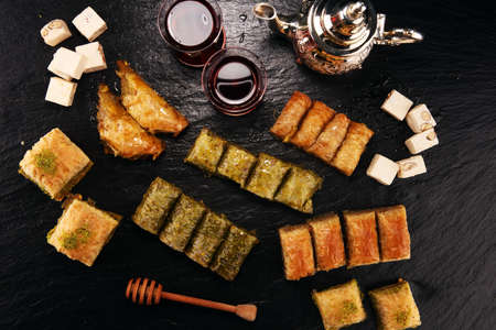 Middle eastern or arabic dishes. Turkish Dessert Baklava with pistachio. Stock Photo