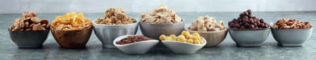 Cereal. Bowls of various cereals for breakfast. Muesli with variety of kids cereals. Imagens