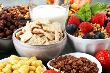 Cereal. Bowls of various cereals, fruits and milk for breakfast. Muesli with variety of kids cereals. Imagens