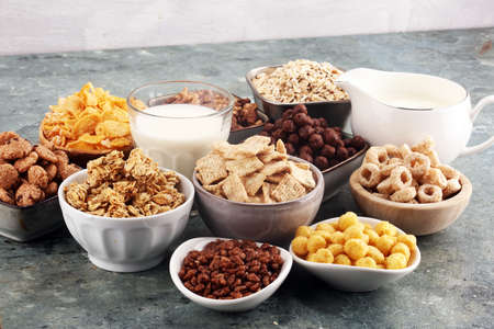 Cereal. Bowls of various cereals and milk for breakfast. Muesli with variety of kids cereals.