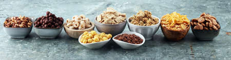 Cereal. Bowls of various cereals for breakfast. Muesli with variety of kids cereals. Stock Photo