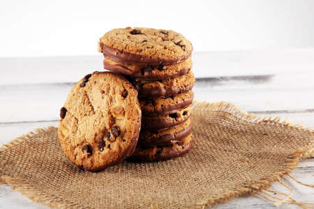 Chocolate cookies on wooden table. Chocolate chip cookies shot on white 写真素材