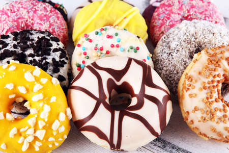 assorted donuts with chocolate frosted, pink glazed and sprinkles donuts. carnival concept with sugar