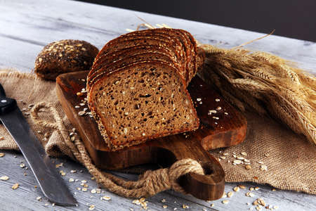 freshly baked bread on wooden board. cutted bread poster design 写真素材