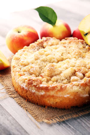Apple pie or homemade cake with apples on table. Delicous dessert apple tart.
