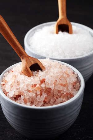 Sea salt and himalayan in bowl. Crystals of salt on rustic table