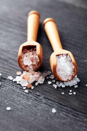 Sea salt and himalayan on spoon. Crystals of salt on rustic table Stock fotó