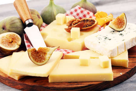 Cheese platter with different cheese and grapes and figs Stok Fotoğraf