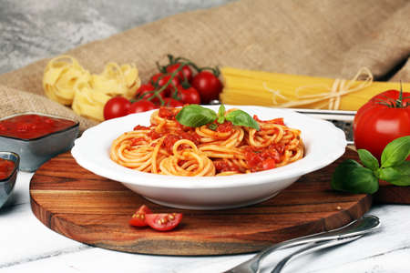 Plate of delicious spaghetti Bolognaise or Bolognese with savory minced beef and tomato sauce garnished with parmesan cheese Stock Photo