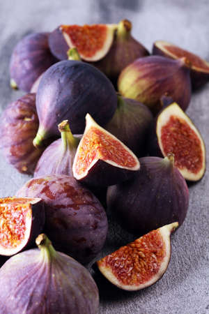Fresh figs. Food Photo. whole and sliced figs on rustic table