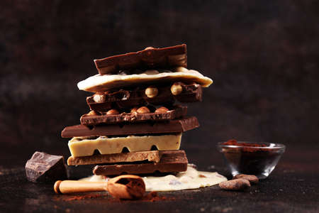 Chocolate bars on a rustic background with chocolate tower Stock Photo