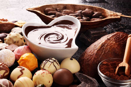 a lot of variety chocolate pralines, belgian confectionery gourmet chocolate on table Stock Photo