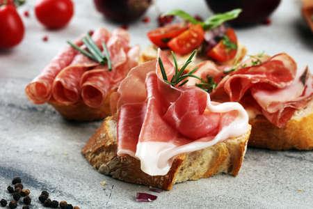 Assorted bruschetta with various toppings. Appetizing bruschetta or crudo crostini. Variety of small sandwiches. Mix bruschetta