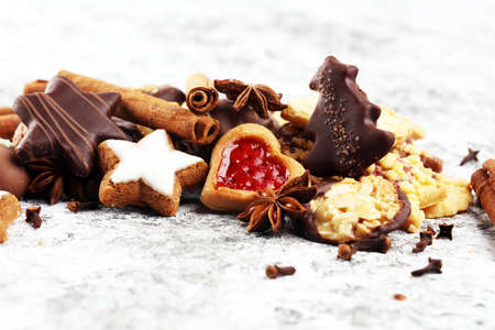 christmas cookies with spieses, nuts and fruits on table Stock Photo