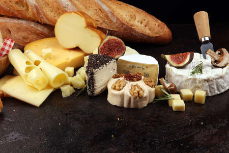 Different sorts of cheese. Cheese platter with different cheese and spices