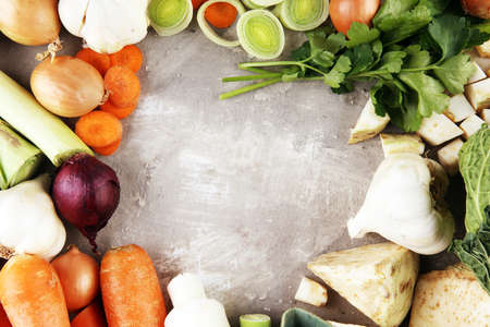 Vegetables cooking ingredients for tasty vegetarian dishes or soup. Carrot , onion , garlic , parsley on rustic background Stock fotó