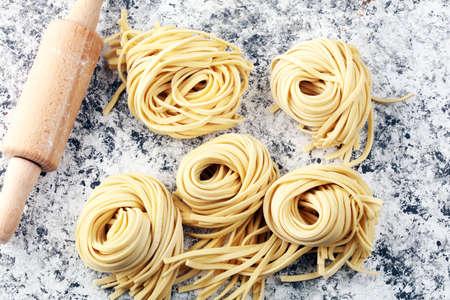 Closeup of raw fresh homemade pasta. fresh italian traditional raw pasta