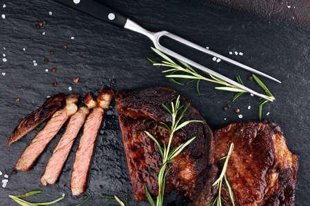 Barbecue Rib Eye Steak or rump steak - Dry Aged Wagyu Entrecote Steak on table