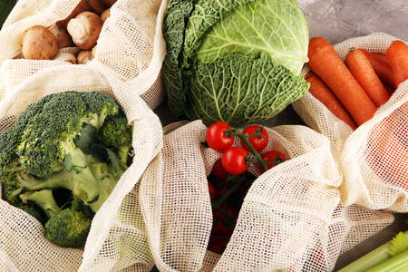 eco natural bags with vegetables, eco friendly, flat lay. sustainable lifestyle concept. zero waste food shopping veggies. plastic free items. reuse, reduce, recycle, refuse Stock fotó