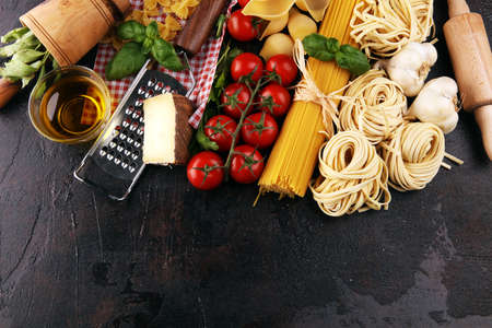 Pasta, vegetables, herbs and spices for Italian food on table Stock fotó