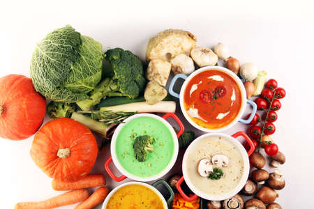 Variety of colorful vegetables cream soups and ingredients for soup. Concept of healthy eating or vegetarian food with mushrooms, pumpkin and broccoli Stock fotó