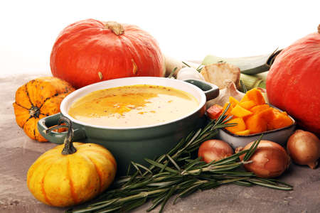 Roasted pumpkin and carrot soup with cream and pumpkin seeds. Healthy food concept