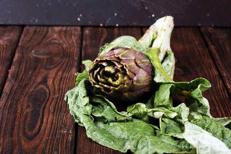 artichokes on rustic background. fresh organic raw artichoke flower