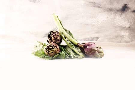 artichokes on grey background. fresh organic raw artichoke flower