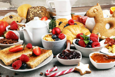 Breakfast served with coffee, orange juice, croissants, cereals and fruits. Balanced diet. Continental breakfast served for brunch at christmas