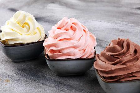 soft ice cream in flavor vanilla, chocolate and strawberry. Delicous creamy ice cream