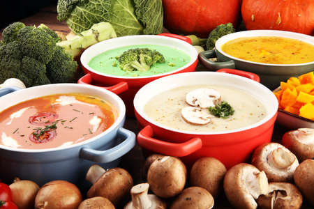Variety of colorful vegetables cream soups and ingredients for soup. Concept of healthy eating or vegetarian food with mushrooms, pumpkin and broccoli Archivio Fotografico
